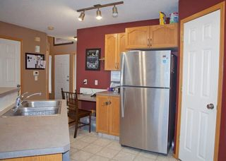 Photo 12: 48 CIMARRON MEADOWS Road: Okotoks House for sale : MLS®# C4174831