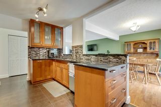Photo 10: 79 Warwick Drive SW in Calgary: Westgate Detached for sale : MLS®# A1131480