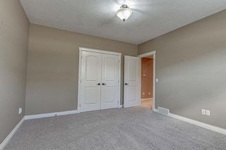 Photo 21: 72 Elysian Crescent SW in Calgary: Springbank Hill Semi Detached for sale : MLS®# A1148526