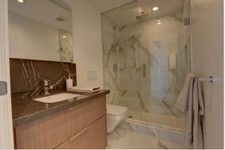 Photo 34: 501 128 Waterfront Court SW in Calgary: Chinatown Apartment for sale : MLS®# A1107113