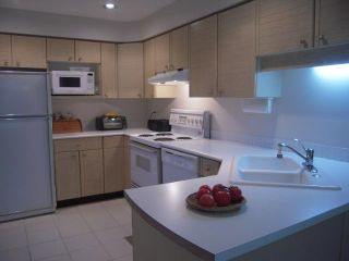 """Photo 1: 1541 BOWSER Avenue in North Vancouver: Norgate Townhouse for sale in """"Illahee"""" : MLS®# V853423"""