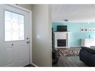 Photo 5: 8 SUN RIDGE Close NW: Airdrie House for sale : MLS®# C4048800