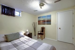 Photo 21: 1052 RANCHVIEW Road NW in Calgary: Ranchlands Semi Detached for sale : MLS®# A1012102