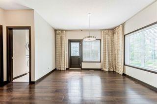 Photo 8: 1015 Evansridge Common NW in Calgary: Evanston Row/Townhouse for sale : MLS®# A1134849