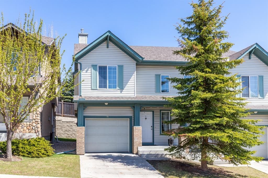 Main Photo: 85 Hidden Creek Rise NW in Calgary: Hidden Valley Row/Townhouse for sale : MLS®# A1104213