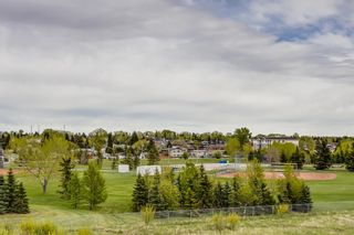 Photo 2: 401 300 Edwards Way NW: Airdrie Apartment for sale : MLS®# A1111826