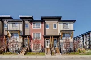 Photo 1: 103 Walgrove Cove SE in Calgary: Walden Row/Townhouse for sale : MLS®# A1145152