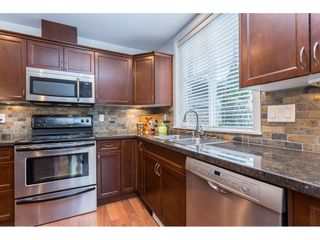 """Photo 16: 108 33338 MAYFAIR Avenue in Abbotsford: Central Abbotsford Condo for sale in """"The Sterling"""" : MLS®# R2558852"""