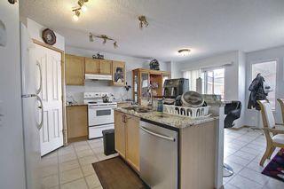 Photo 8: 145 Taravista Crescent NE in Calgary: Taradale Detached for sale : MLS®# A1125771