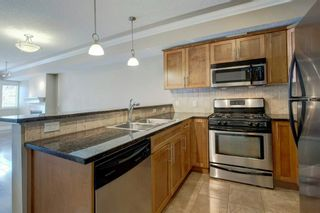 Photo 15: 102 1728 35 Avenue SW in Calgary: Altadore Row/Townhouse for sale : MLS®# A1101740