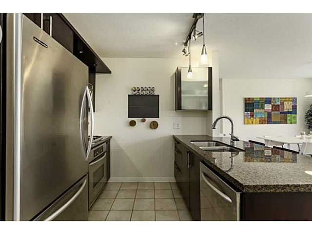 """Photo 4: Photos: 404 1650 W 7TH Avenue in Vancouver: Fairview VW Condo for sale in """"VIRTU"""" (Vancouver West)  : MLS®# V1079673"""