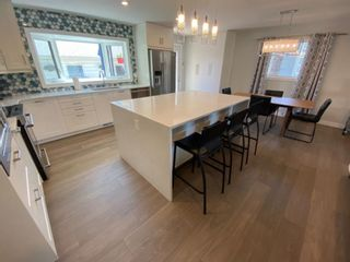 Photo 5: 419 Woodbend Road SE in Calgary: Willow Park Detached for sale : MLS®# A1075993