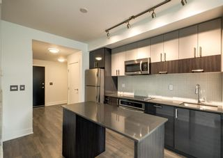 Photo 3: 409 550 Riverfront Avenue SE in Calgary: Downtown East Village Apartment for sale : MLS®# A1139717