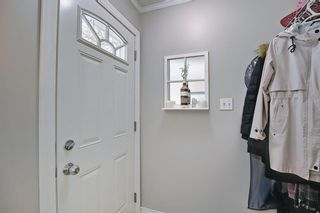 Photo 3: 787 Kingsmere Crescent SW in Calgary: Kingsland Row/Townhouse for sale : MLS®# A1108605