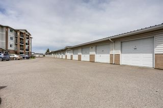 Photo 17: 401 300 Edwards Way NW: Airdrie Apartment for sale : MLS®# A1111826