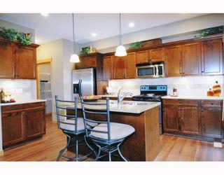 "Photo 2: 76 24185 106B Avenue in Maple Ridge: Albion Townhouse for sale in ""TRAILS EDGE"" : MLS®# V810262"