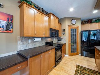 Photo 13: 7 Springbluff Boulevard in Calgary: Springbank Hill Detached for sale : MLS®# A1124465