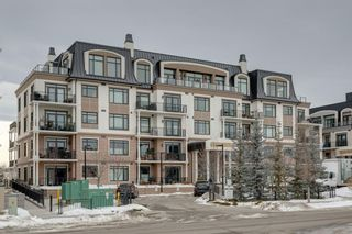 Photo 2: 101 131 Quarry Way SE in Calgary: Douglasdale/Glen Apartment for sale : MLS®# A1062377