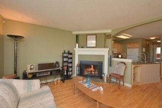 Photo 4: 267 GLENPATRICK Drive: Cochrane House for sale : MLS®# C4139469