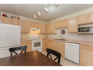 """Photo 10: 202 5955 177B Street in Surrey: Cloverdale BC Condo for sale in """"WINDSOR PLACE"""" (Cloverdale)  : MLS®# R2160255"""