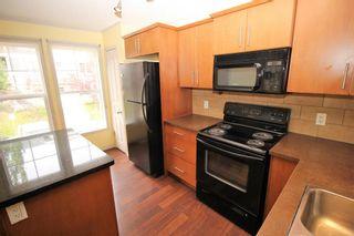 Photo 4: 29 Auburn Bay Common SE in Calgary: Auburn Bay Row/Townhouse for sale : MLS®# A1141963
