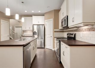 Photo 10: 150 AUTUMN Circle SE in Calgary: Auburn Bay Detached for sale : MLS®# A1089231