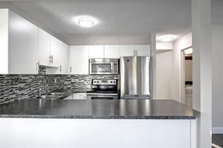 Photo 8: 29 Country Hills Rise NW in Calgary: Country Hills Row/Townhouse for sale : MLS®# A1149774