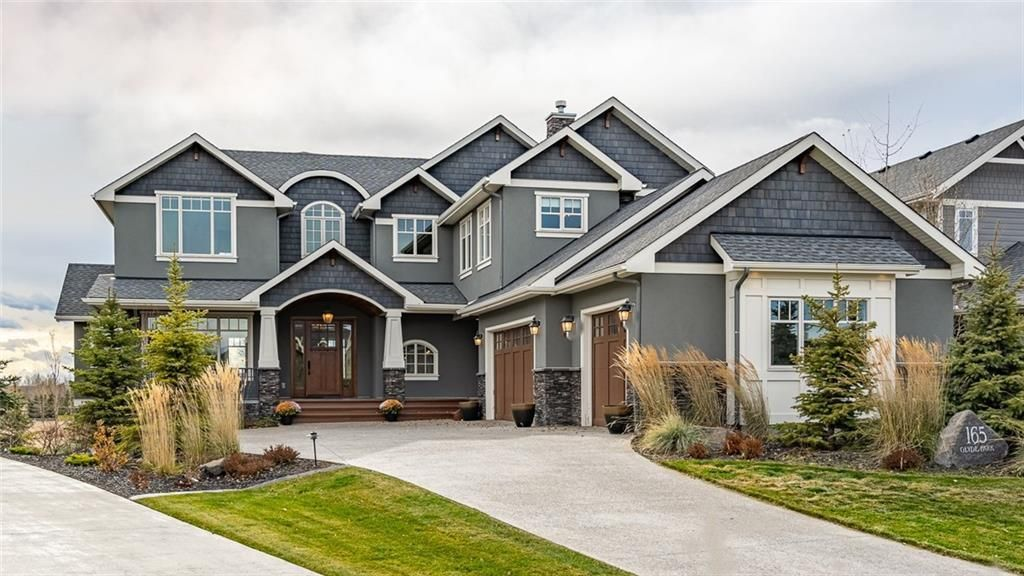 Inviting Elevation with mountain views from four patio areas