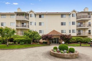 """Photo 1: 207 22611 116 Avenue in Maple Ridge: East Central Condo for sale in """"ROSEWOOD COURT"""" : MLS®# R2468837"""
