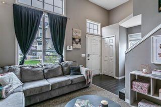 Photo 3: 3168 New Brighton Gardens SE in Calgary: New Brighton Row/Townhouse for sale : MLS®# A1118904