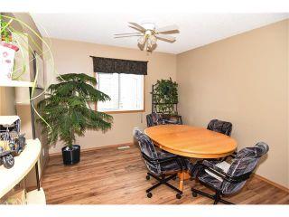 Photo 11: 22 Cimarron Meadows Way: Okotoks House for sale : MLS®# C4104563