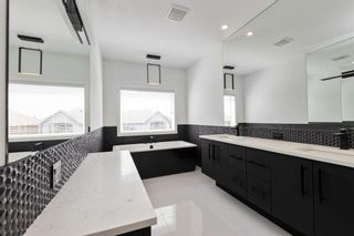 Photo 33: 7853 8a Avenue SW in Calgary: West Springs Detached for sale : MLS®# A1120136
