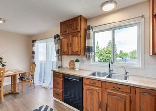 Photo 8: 26 River Rock Way SE in Calgary: Riverbend Detached for sale : MLS®# A1147690