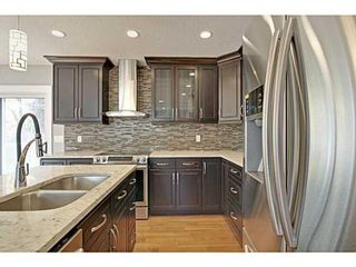 Photo 5: 27 Meadowview Road SW in Calgary: Meadowlark Park Detached for sale : MLS®# A1084197