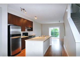 "Photo 3: 27 19572 FRASER Way in Pitt Meadows: South Meadows Townhouse for sale in ""COHO II"" : MLS®# V1069837"
