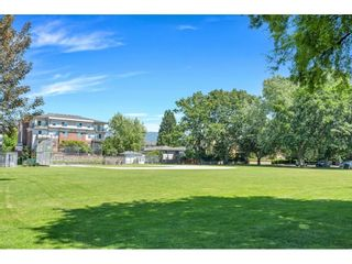 """Photo 30: 220 2110 ROWLAND Street in Port Coquitlam: Central Pt Coquitlam Townhouse for sale in """"AVIVA ON THE PARK"""" : MLS®# R2598714"""