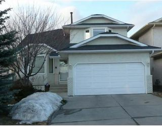 Photo 1: 194 ARBOUR SUMMIT Close NW in CALGARY: Arbour Lake Residential Detached Single Family for sale (Calgary)  : MLS®# C3365625