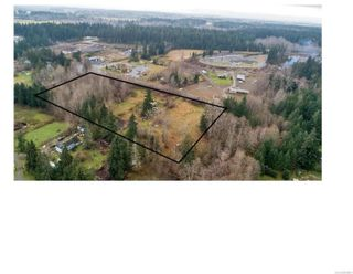 Main Photo: 8712 N Island Hwy in : CV Merville Black Creek House for sale (Comox Valley)  : MLS®# 860801