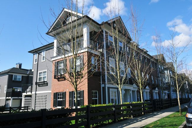 This Georgian inspired row home in family friendly Osprey Village oozes with street appeal.