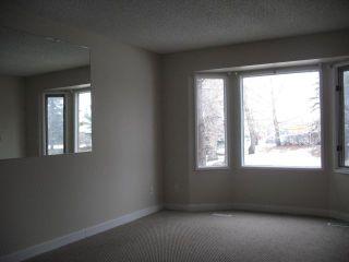 Photo 3: 91 FALSHIRE Terrace NE in CALGARY: Falconridge Townhouse for sale (Calgary)  : MLS®# C3546557