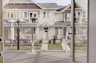 Photo 7: 124 AUBURN MEADOWS Walk SE in Calgary: Auburn Bay Row/Townhouse for sale : MLS®# C4273742