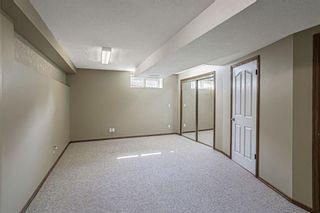 Photo 24: 426 Riverview Green: Cochrane Detached for sale : MLS®# A1132015