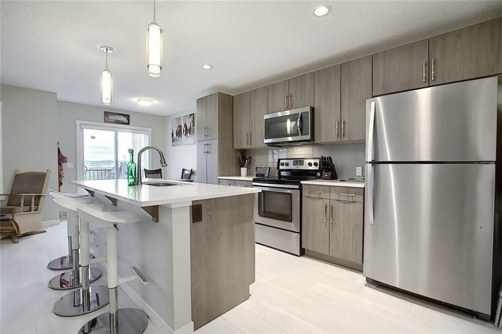 Main Photo: 403 Sunrise View: Cochrane Semi Detached for sale : MLS®# C4301233