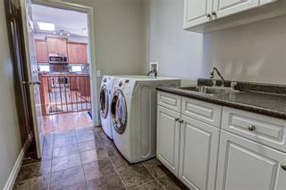 Photo 32: 7 ELYSIAN Crescent SW in Calgary: Springbank Hill Semi Detached for sale : MLS®# A1104538