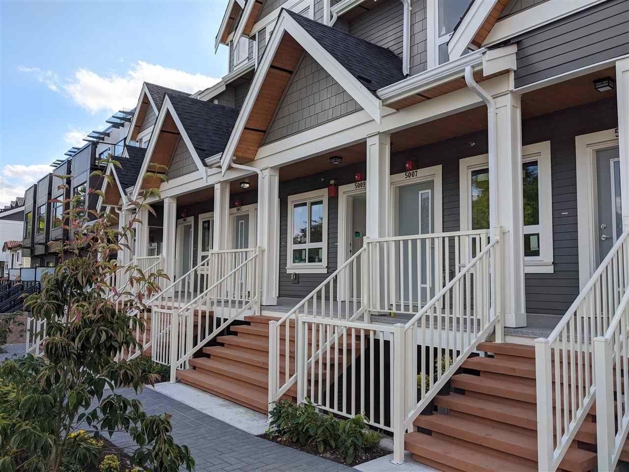 """Main Photo: 5019 CHAMBERS Street in Vancouver: Collingwood VE Townhouse for sale in """"CHAMBERS"""" (Vancouver East)  : MLS®# R2529252"""
