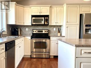 Photo 6: 255 Meadowbrook Drive E in Brooks: House for sale : MLS®# A1113573