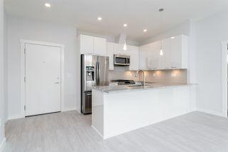 "Photo 3: 404 2356 WELCHER Avenue in Port Coquitlam: Central Pt Coquitlam Condo for sale in ""Mackenzie Park"" : MLS®# R2602800"