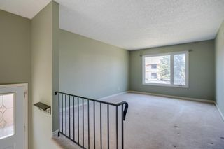 Photo 8: 136 Silvergrove Road NW in Calgary: Silver Springs Semi Detached for sale : MLS®# A1098986