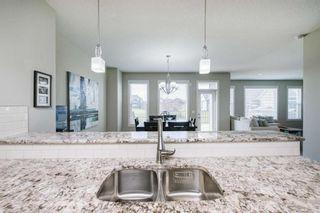 Photo 10: 257 BOULDER CREEK Crescent: Langdon Detached for sale : MLS®# A1016379