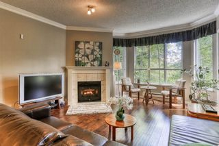 """Photo 1: 204 5646 200 Street in Langley: Langley City Condo for sale in """"Cambridge Court"""" : MLS®# R2384457"""